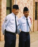 Then, Amn 1st Class, now, 1st Lt. Kenneth Ellison stands next to his uncle, Chief Master Rodney Ellison during his technical school graduation in 2004. Lieutenant Ellison graduated from Commissioned Officer Training June 22 at Maxwell Air Force Base, Ala and is continuing his family's tradition of service, which dates back to September 1947, when his grandfather started Air Force Basic Training.