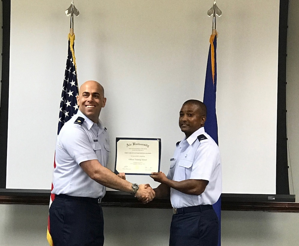 1st Lieutenant Kenneth Ellison receives his diploma from Maj. Francisco Costa upon completion of Commissioned Officer Training Class 18-04, Friday, June 22. Ellison commissioned after 14 years of enlisted service and continues his family's legacy of continuous Air Force service since his grandfather enlisted in 1947.