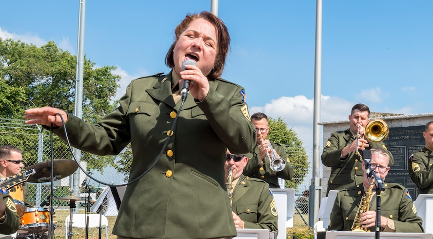 Master Sgt. Michele Harris and members of the United States Air Forces in Europe jazz band performing during the ceremony for the 70th anniversary of the Berlin Airlift, June 26, 2018, in Frankfurt, Germany. The Berlin Airlift memorial ceremony honored the 70th Anniversary of the beginning of the Berlin Airlift. The event also honored the 101 lives lost from the participating countries. (U.S. Air Force photo by Senior Airman Nick Emerick)