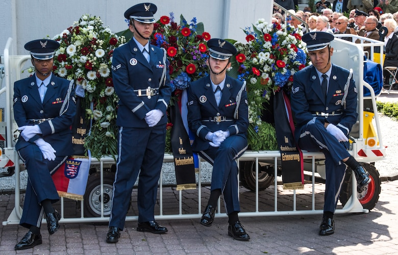 Members of the Ramstein Air Base honor guard during the ceremony for the 70th anniversary of the Berlin Airlift, June 26, 2018, in Frankfurt, Germany. The Berlin Airlift memorial ceremony honored the 70th Anniversary of the beginning of the Berlin Airlift. The event also honored the 101 lives lost from the participating countries. (U.S. Air Force photo by Senior Airman Nick Emerick)