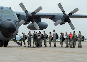 U.S. Air Force Airmen from the 133rd Airlift Wing prepare to take off in a C-130 Hercules in St. Paul, Minn., May 19, 2018.
