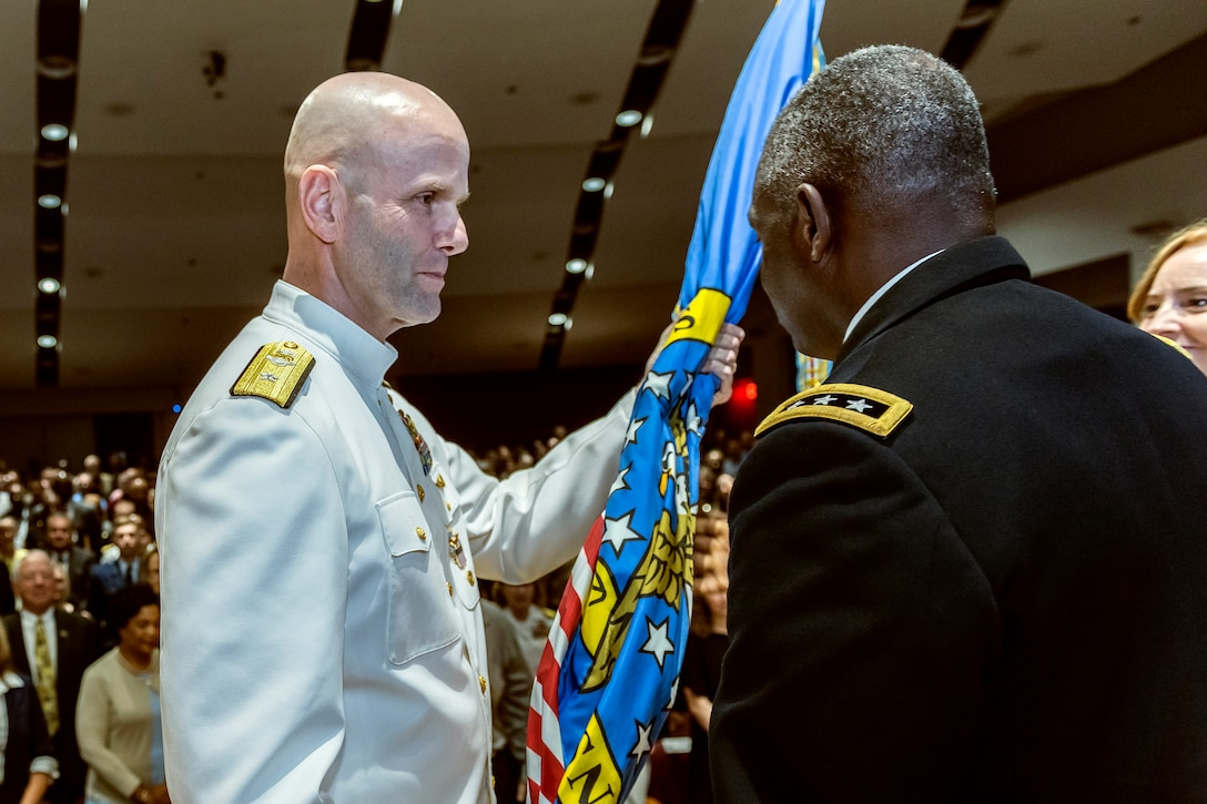 Rear Adm. John Palmer took command of DLA Land and Maritime and DSCC
