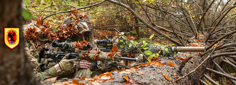 A two-man sniper team prepares to take a shot at a target during the Basic Sniper Course, conducted by the International Special Training Centre at the Joint Multinational Readiness Center in Hohenfels, Germany, October 23, 2017. The ISTC is a multinational education and training facility which provides advanced and specialized training at the tactical level for Special Operations Forces and similar units from the Memorandum of Understanding, NATO and Partnership for Peace nations. (SOCEUR Photo by 1st Lt. Benjamin Haulenbeek)