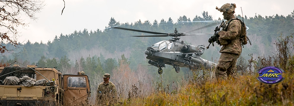 An AH-64 Apache attack helicopter takes off near Soldiers participating in the Allied Spirit VII training exercise Nov. 18, 2017.   Approximately 3,700 service members from 13 nations gathered in 7th Army Training Command's Hohenfels Training Area in southeastern Germany to participate in the seventh iteration of Allied Spirit which is scheduled for Oct. 30 - Nov. 22, 2017. The U.S. Army, along with its NATO allies and partners, continue to forge a dynamic presence with a powerful land network that simultaneously deters aggression and assures the security of the region.  (U.S. Army photo by Spc. Dustin D. Biven / 22nd Mobile Public Affairs Detachment)