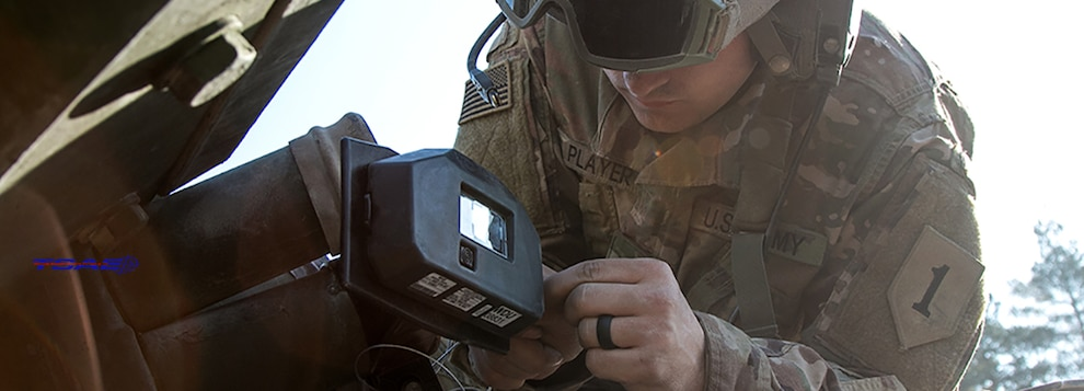 Pvt. Tyler Player, an infantryman assigned to 1st Battalion, 63rd Armor Regiment, 2nd Armored Brigade Combat Team, 1st Infantry Division, Fort Riley, Kansas, installs Multiple Integrated Laser Engagement System (MILES) gear to a M2 Bradley fighting vehicle at Grafenwoehr, Germany in preparation for a field exercise during Combined Resolve X, April 10, 2018. The goal of Combined Resolve is to prepare forces in Europe to work together to promote stability and security in the region. (U.S. Army photo by Spc. Dustin D. Biven / 22nd Mobile Public Affairs Detachment)