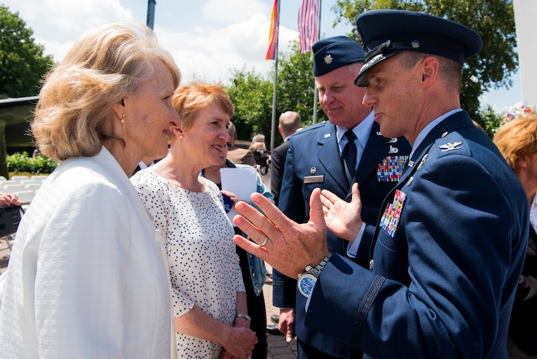 Denise Halvorsen-Williams, left, and Marilyn Halvorsen-Sorenson, daughters of Ret. Col. Gail S. Halvorsen, known as the Candy Bomber, speak with U.S. Air Force Col. Tad D. Clark, 52nd Fighter Wing vice commander, and U.S. Air Force Lt. Col. Shannon Caleb, commander of the 726th Air Mobility Squadron, both from Spangdahlem Air Base, at the Berlin Airlift 70th anniversary commemoration at Frankfurt International Airport, Germany, June 26, 2018. The Candy Bomber played a major role during the historic event by dropping 23 tons of candy to children. (U.S. Air Force photo by Airman 1st Class Valerie Seelye)