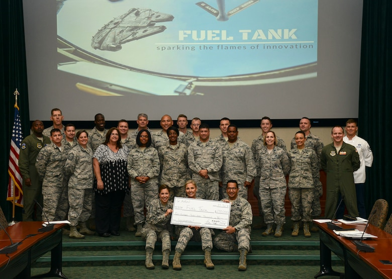 MacDill Fuel Tank presenters, judges and coordinators pause for a group photo after awarding $237,000 to ten innovative ideas at MacDill Air Force Base, Fla., June, 27, 2018.