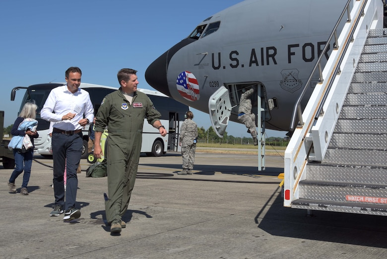 U.S. Air Force Col. Christopher Amrhein, 100th Air Refueling Wing commander, leads a group of honorary commanders onto a U.S. Air Force KC-135 Stratotanker during Honorary Commanders Day at RAF Mildenhall, England, June 26, 2018. Honorary Commanders Day is an event that provides an opportunity to foster relations between the base and the local community. (U.S. Air Force photo by Airman 1st Class Benjamin Cooper)