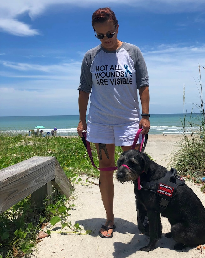 Air Force veteran Stacey Pavenski, 46, of Palm Bay, Florida, is on a journey to bring awareness to PTSD and traumatic brain injury disorders that lead 22 veterans a day to take their own lives. Her husband Air Force Master Sgt. Pete Pavenski took his own life Sept. 18, 2018. Joining forces with various organizations that provide assistance, Stacey is sharing her story during PTSD Awareness Month and getting the resources out there. (U.S. Air Force photo by Maj. Cathleen Snow)