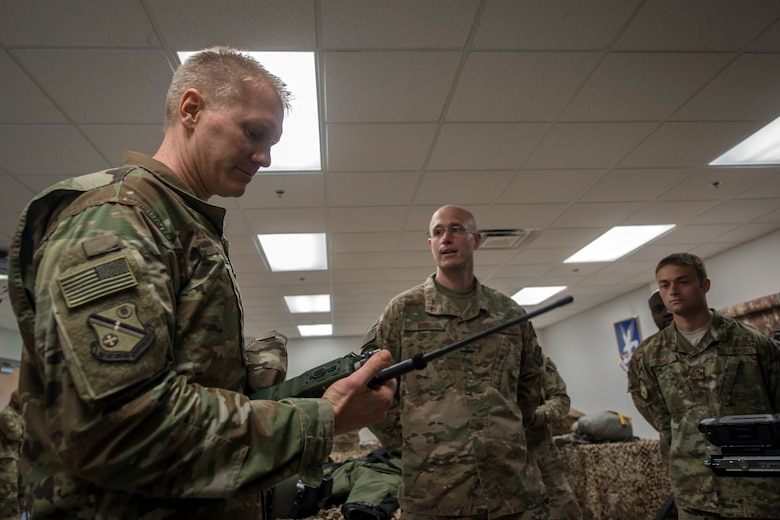 Col. Paul Birch, 93d Air Ground Operations Wing (AGOW) commander, inspects a radio communication device during an immersion tour, June 25, 2018, at Moody Air Force Base, Ga. Birch toured the 820th Base Defense Group to gain a better understanding of their overall mission, duties and comprehensive capabilities. Prior to taking command of the 93d AGOW, Birch was the commander of the 380th Expeditionary Operations Group at Al Dhafra Air Base, United Arab Emirates. (U.S. Air Force photo by Airman 1st Class Eugene Oliver)