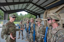 Col. Paul Birch, 93d Air Ground Operations Wing (AGOW) commander, speaks to Airmen from the 820th Base Defense Group (BDG) during an immersion tour, June 25, 2018, at Moody Air Force Base, Ga. Birch toured the BDG to gain a better understanding of their overall mission, duties and comprehensive capabilities. Prior to taking command of the 93d AGOW, Birch was the commander of the 380th Expeditionary Operations Group at Al Dhafra Air Base, United Arab Emirates. (U.S. Air Force photo by Airman 1st Class Eugene Oliver)