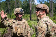 Tech Sgt. Daniel Green, left, 822d Base Defense Squadron fire team leader, briefs Col. Paul Birch, 93d Air Ground Operations Wing (AGOW) commander, during an immersion tour, June 25, 2018, at Moody Air Force Base, Ga. Birch toured the 820th Base Defense Group to gain a better understanding of their overall mission, duties and comprehensive capabilities. Prior to taking command of the 93d AGOW, Birch was the commander of the 380th Expeditionary Operations Group at Al Dhafra Air Base, United Arab Emirates. (U.S. Air Force photo by Airman 1st Class Eugene Oliver)