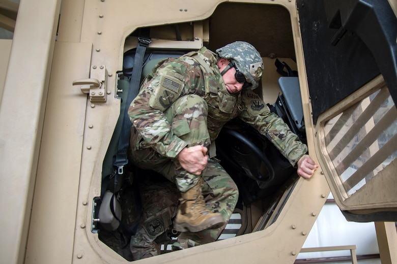 Col. Paul Birch, 93d Air Ground Operations Wing (AGOW) commander, steps out of a mine-resistant, ambush-protected vehicle roll-over simulator during an immersion tour, June 25, 2018, at Moody Air Force Base, Ga. Birch toured the 820th Base Defense Group to gain a better understanding of their overall mission, duties and comprehensive capabilities. Prior to taking command of the 93d AGOW, Birch was the commander of the 380th Expeditionary Operations Group at Al Dhafra Air Base, United Arab Emirates. (U.S. Air Force photo by Airman 1st Class Eugene Oliver)