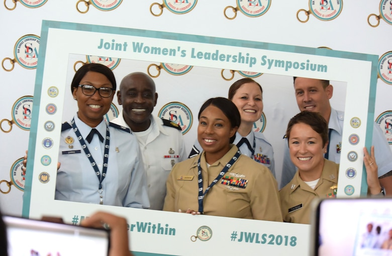 Service members pose for a photo at the 2018 Joint Women's Leadership Symposium June 21, 2018, in San Diego. The symposium included attendees from the U.S. Air Force, Army, Navy, Marine Corps, and Coast Guard and 20 other countries. (U.S. Air Force photo by 1st Lt. Annabel Monroe)