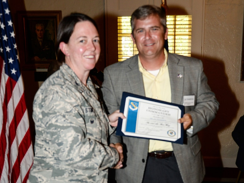 Colonel Melissa Stone, vice commander of the 42nd Air Base Wing, Maxwell Air Force Base, Alabama, congratulates her Honorary Commander, Jay Thompson, chairman of the Autauga, Alabama, County Commission, during the Honorary Commander Induction Ceremony at the Maxwell Club, June 19, 2018. (Air Force photo by Tech. Sgt. Patrick Brown)