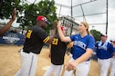 AFOSI's Staff Sgt. Bobbi Robinson, JBAB, Md., high fives an Army player after the Air Force edged the Soldiers 16-15, on their way to a berth in the inaugural All-Star Armed Services Classic Tournament Championship at Washington Nationals Park, July 13, 2018. The title game will be the first major ballpark event of MLB's All-Star Week. (Photo by Cory Royster)