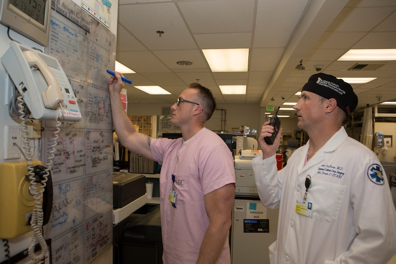 Col. Joseph DuBose, trauma surgeon and Center for the Sustainment of Trauma and Readiness Skills (C-STARS) Baltimore director, and Master Sgt. Shane Patterson, a respiratory therapist and C-STARS Baltimore superintendent, receive a report on an incoming patient at the Trauma Resuscitation Unit at the University of Maryland Medical Center, Baltimore, June 13, 2018. The Air Force's C-STARS Baltimore program partners with the R Cowley Shock Trauma Center at the University of Maryland Medical Center to ensure medical Airmen train on the latest trauma care techniques. These techniques prepare medical Airmen to treat trauma patients in a deployed setting. (Courtesy photo)