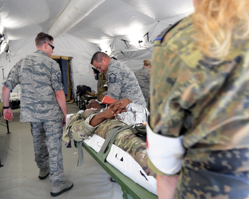 Airmen from the 86th Medical Group conducted Ability to Survive and Operate training in an Expeditionary Medical Support System modular field hospital during en route patient staging training during Exercise Maroon Surge on Ramstein Air Base, Germany, June 9, 2018. ATSO training is designed to improve Airmen's performance during stressful circumstances. (U.S. Air Force photo by Airman 1st Class Ariel Leighty)