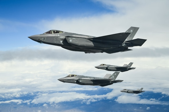 Four F-35 Lightning IIs fly in formation