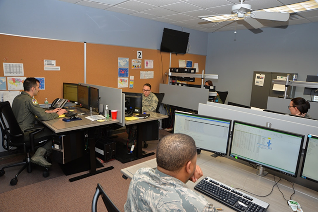 Air Force Coordination Center staff at work on the controller floor. The AFRCC is responsible for assisting coordination with all inland search and rescue requests, 24/7/365,   from around the continental United States. (U.S. Air National Guard photo by Maj. Andrew Scott)