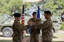 Col. Aaron Ullman, left, 3rd Air Support Operations Group commander, and Lt. Col. Frank Biancardi, outgoing 11th Air Support Operations Squadron (ASOS) commander, unfurl a guidon during a squadron inactivation ceremony, June 21, 2018, at Fort Hood, Texas. As a part of the 93d Air Ground Operations Wing from Moody Air Force Base, Ga., the 11th ASOS 'Steel Eagles' mission will remain unchanged as they continue to support Ft. Hood and absorb into the 9th ASOS. The enhanced 9th ASOS will continue to provide tactical air support to align with any U.S. Army unit that needs air support for their scheme of maneuver. (U.S. Air Force photo by Senior Airman Daniel Snider)