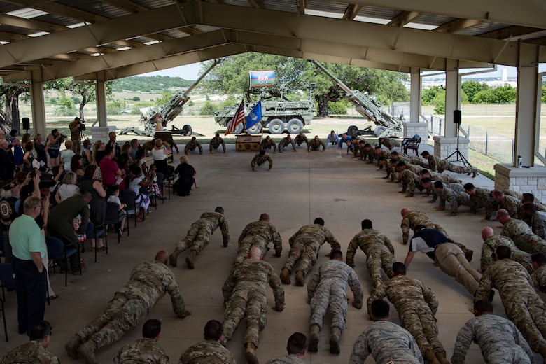 Past and present members of the 11th Air Support Operations Squadron perform memorial pushups during a squadron inactivation ceremony, June 21, 2018, at Fort Hood, Texas. As a part of the 93d Air Ground Operations Wing from Moody Air Force Base, Ga., the 11th ASOS 'Steel Eagles' mission will remain unchanged as they continue to support Ft. Hood and absorb into the 9th ASOS. The enhanced 9th ASOS will continue to provide tactical air support to align with any U.S. Army unit that needs air support for their scheme of maneuver. (U.S. Air Force photo by Senior Airman Daniel Snider)