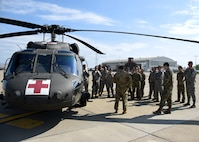 Members of the Pittsburgh International Airport Air Reserve Station Aeromedical Staging Squadron and Aeromedical Evacuation Squadron receive training on how to load a patient onto a helicopter at the Pittsburgh International Airport Air Reserve Station June 26, 2018. This was part of their joint training and was something these medical squadrons do not get to do often.(U.S. Air Force Photo by Senior Airman Grace Thomson)
