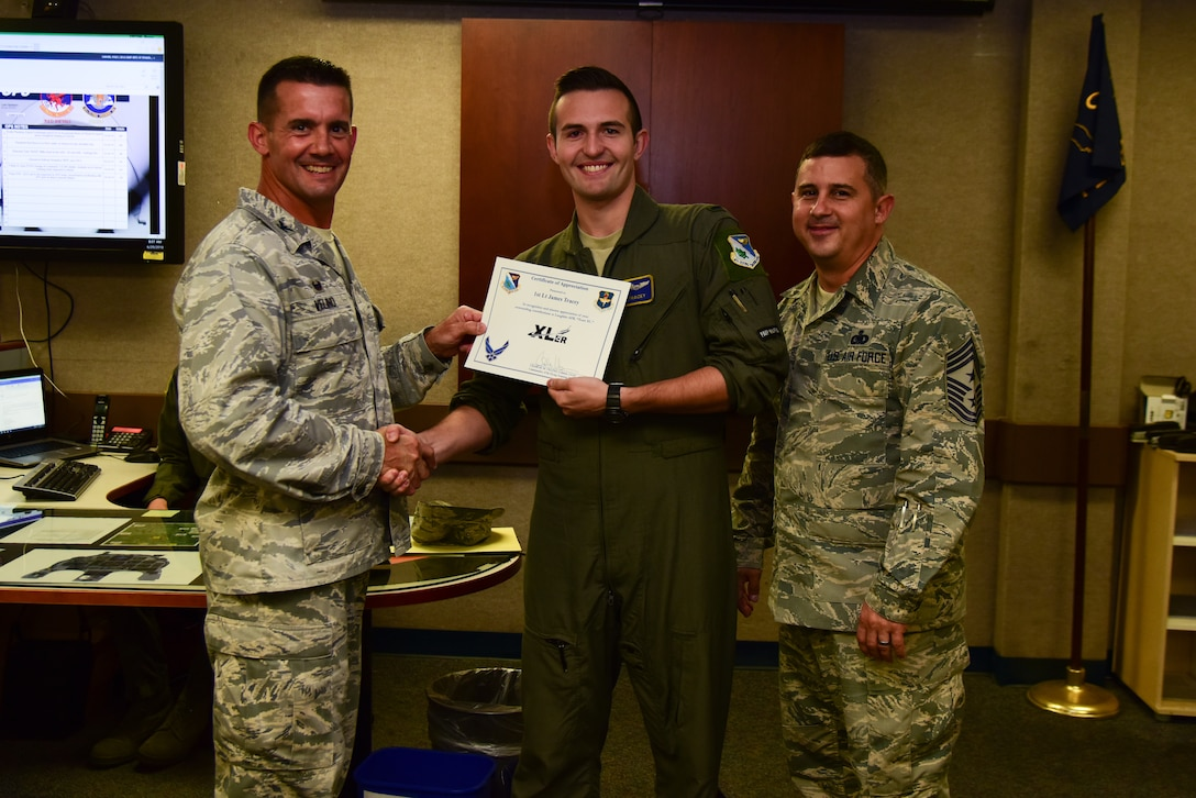 "First Lt. James Tracey, 85th Flying Training Squadron instructor pilot, was chosen by wing leadership to be the ""XLer"" of the week, for the week of May 9, 2018, at Laughlin Air Force Base, Texas. The ""XLer"" award, presented by Col. Charlie Velino, 47th Flying Training Wing commander, is given to those who consistently make outstanding contributions to their unit and the Laughlin mission. (U.S. Air Force photo by Airman 1st Class Marco Gomez)"