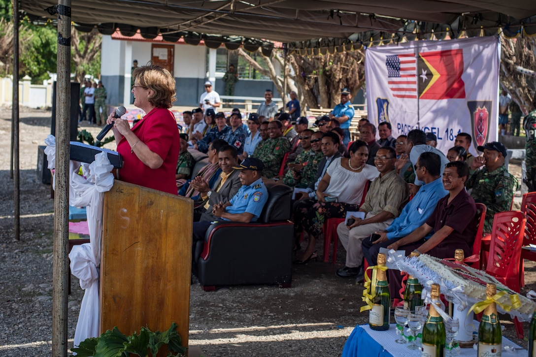 Kathleen Fitzpatrick, U.S. Ambassador to the Democratic Republic of Timor-Leste, addresses attendees of the Pacific Angel (PAC ANGEL) 2018 closing ceremonies at the Negri Saran Kote Secondary School in Suai, Cova Lima Municipality, Southwest Timor-Leste, June 18, 2018