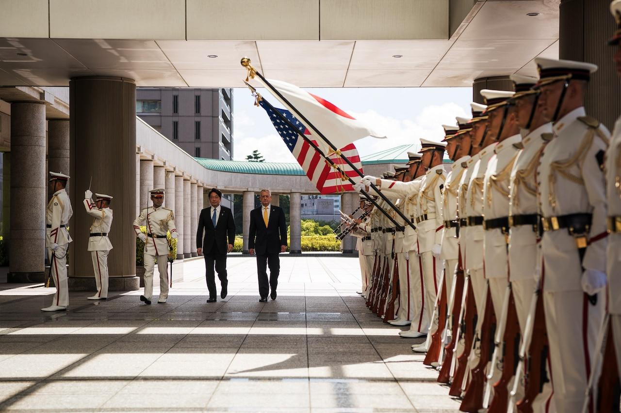Defense Secretary James N. Mattis walks with Japanese Defense Minister Itsunori Onodera in Tokyo.