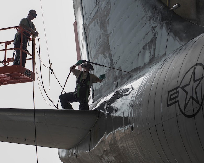 Air National Guard Staff Sgt. Robert Gouhin and Tech Sgt. Brennen Johnson, both crew chiefs with the 121st Air Refueling Wing, Ohio, wash a KC-135 Stratotanker in a hangar at Rickenbacker Air National Guard Base, Ohio June 13, 2018. (U.S. Air National Guard photo by Airman 1st Class Tiffany A. Emery)