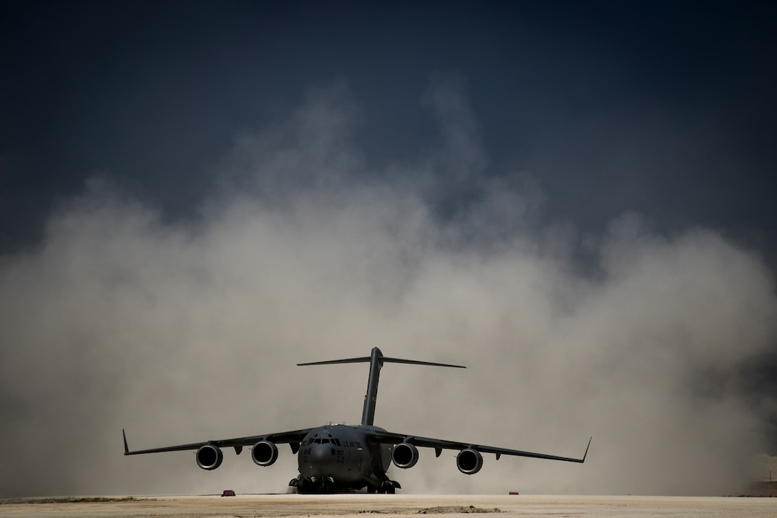 A C-17 Globemaster III readies for departure from an undisclosed location, June 23, 2018. C-17s can airdrop both cargo and personnel, and are able to land on small, austere runways as short as 3,000 feet with a full load. (U.S. Air Force Photo by Staff Sgt. Corey Hook)