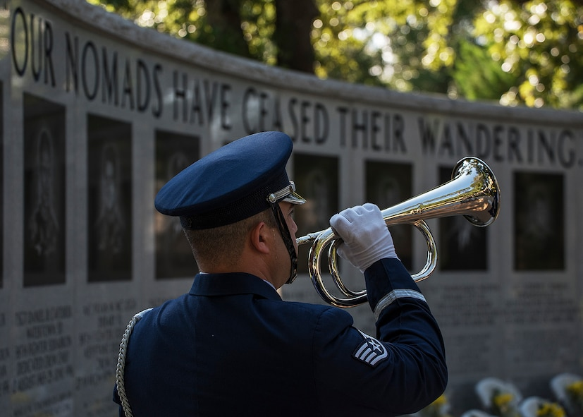 Staff Sgt. Christopher Morris, honor guardsman, holds a trumpet as Taps is played during a Khobar Towers Memorial Ceremony June 25, 2018, at Eglin Air Force Base, Fla. (U.S. Air Force photo by Staff Sgt. Peter Thompson)