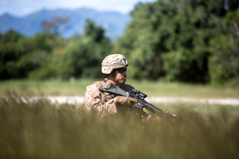 "U.S. Marine Corps Lance Cpl. Joseph Manzie, combat engineer with Marine Rotational Force Darwin, provides security during patrol sweeps at Koumac, New Caledonia, May 20, 2018. Sweeps are typically conducted to search for materials in the ground that may be used against friendly forces or be of intelligence value. ""Being a CE is that my job is so versatile,"" said Manzie. ""I have to ability to perform actions that can change the battlespace, such as breaching, sweeping, or engineer reconnaissance."""