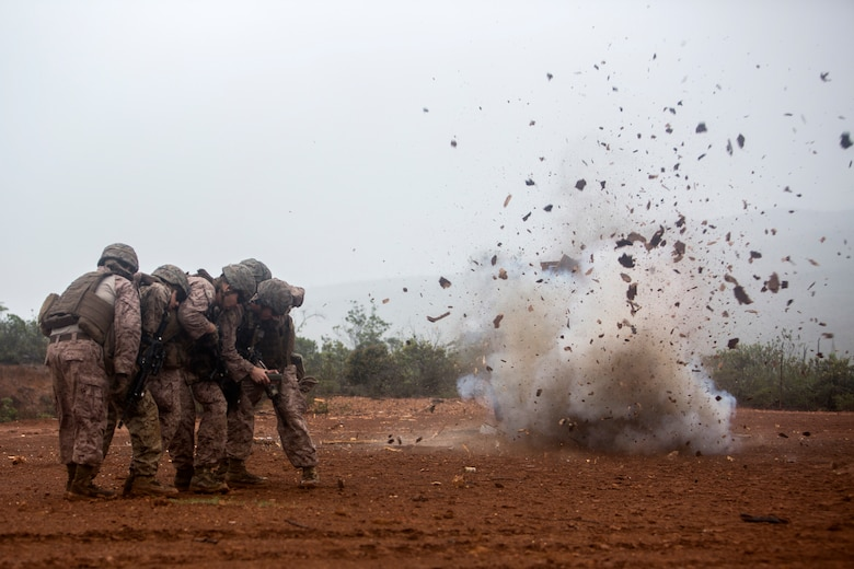 U.S. Marines Corps Combat Engineers with Marine Rotational Force Darwin, detonate an oval charge during a breach at Plum, New Caledonia, May 16, 2018. As a Combat Engineer, performing a breach is an objective that can be tasked if necessary. Their capabilities are both constructive, e.g., building bunkers, providing utilities and destructive, e.g., demolition and breaching support capabilities to the battlefield. This unique combination of capabilities provides knowledge, experience and skills to commanders at the operational and tactical levels with which they can, according to Marine Corps Warfighting Publication 3-34, reduce friction, facilitate maneuver and improve the morale of friendly forces or create friction and disorder for the enemy.