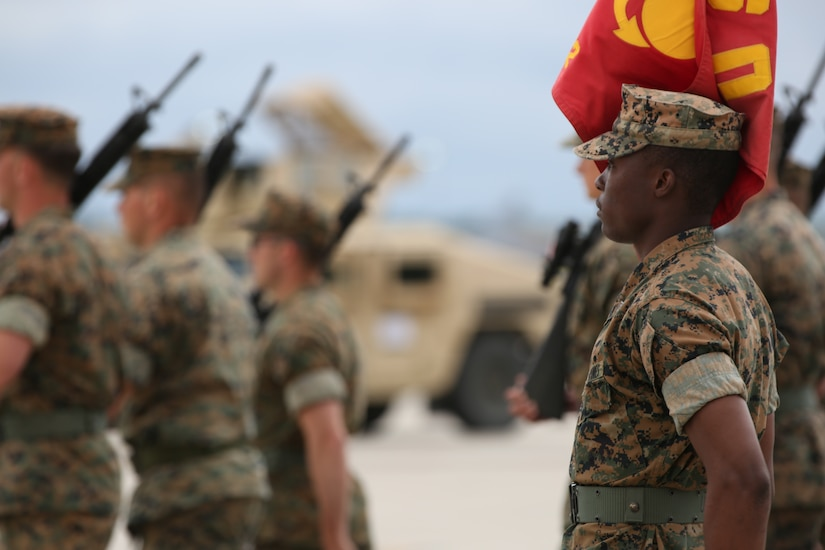 U.S. Marine Corps Sgt. Rasheed Whittle, platoon guide with Marine Wing Support Squadron 472, Marine Aircraft Group-49, 4th Marine Aircraft Group, marches with the platoon on Joint Base McGuire-Dix-Lakehurst, N.J., June 22, 2018. The Marine appointed to be guide has the honor of carrying their units' guidon. (U.S. Marine Corps photo by Cpl. David A. Torres)