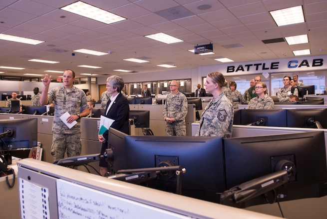 Capt. Benjamin Wiemers, 624th Operations Center plans chief, explains the 624th OC mission to Secretary of the Air Force Heather Wilson during her visit to Joint Base San Antonio-Lackland, Texas, June 28, 2018. During her visit, Wilson met Air Forces Cyber Airmen and learned about their contributions to the cyber mission. (U.S. Air Force photo by Tech. Sgt. R.J. Biermann)