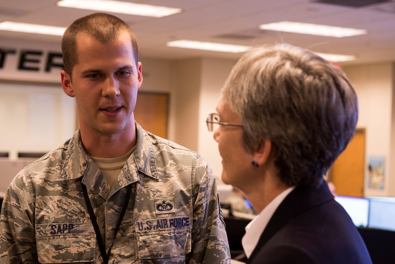 Tech. Sgt. William Sapp, 624th Operations Center command and control battle management operator, talks with Secretary of the Air Force Heather Wilson during her visit to Joint Base San Antonio-Lackland, Texas, June 28, 2018. During her visit, Wilson met Air Forces Cyber Airmen and learned about their contributions to the cyber mission. (U.S. Air Force photo by Tech. Sgt. R.J. Biermann)