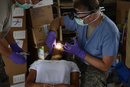 A Salvadoran girl gets dental care during a medical readiness training exercise June 24, 2018, at Centro Escolar Canton La Esperanza de Olocuilta, El Salvador. The MEDRET is part of U.S. Army South-led Beyond the Horizon exercise lasting May 12 through August 4. The exercise involves about 1,800 Soldiers of all components, part of Combined Joint Task Force Hope and includes MEDRETS and construction of schools and a clinic addition.