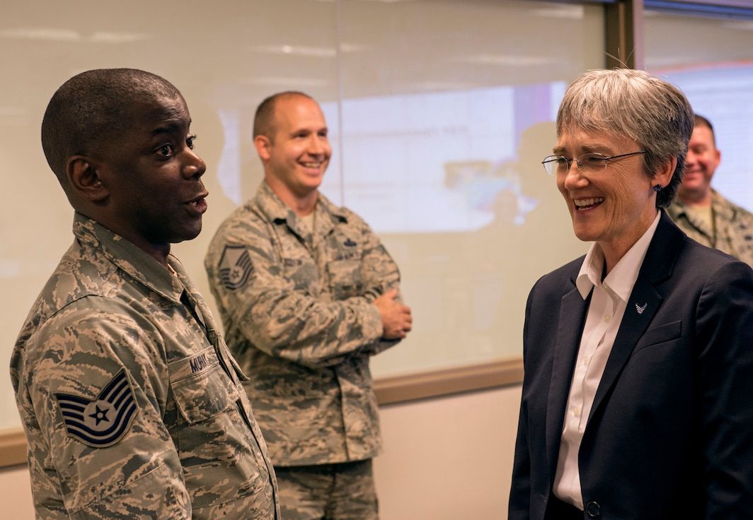 Tech. Sgt. Bruce Murray, 624th Operations Center defensive cyber operator, shares a joke with Secretary of the Air Force Heather Wilson during her visit to Joint Base San Antonio-Lackland, Texas, June 28, 2018. During her trip, Wilson met Air Forces Cyber Airmen and learned about their contributions to the cyber mission. (U.S. Air Force photo by Tech. Sgt. R.J. Biermann)
