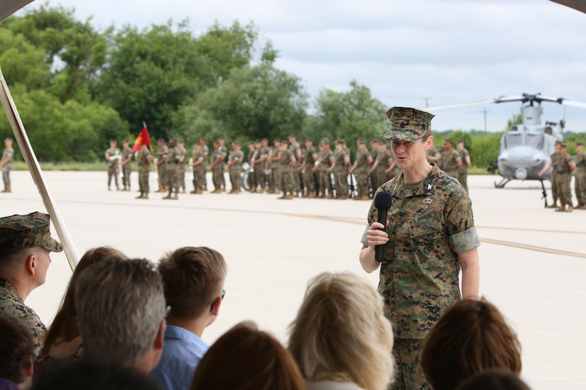 U.S. Marine Corps Col. Alison Thompson, Marine Aircraft Group 49 commander, speaks to those in attendance during the MAG-49 change of command ceremony on Joint Base McGuire-Dix-Lakehurst, N.J., June 22, 2018. During the ceremony, Marine Col. Robert Braatz relinquished command of the MAG-49 to Thompson. (U.S. Marine Corps photo by Cpl. David Torres.)