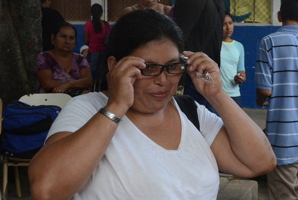 Reina Chavez, 43, has had great difficulty in reading. The strain on her eyes, she said, resulted in burning and itching. She was seen by optometry and received her first-ever pair of eyeglasses.