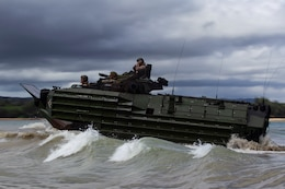 Marines with Echo Company, Battalion Landing Team, 2nd Battalion, 5th Marines, riding Assault Amphibious Vehicles, head toward the shore during a mechanized assault as part of the 31st Marine Expeditionary Unit's MEU Exercise, near Ginoza Village, Okinawa, Japan, June 28, 2018. Marines and Sailors with Echo Company performed the final training event of MEUEX, an assault launched from Camp Schwab and targeting Combat Town, part of Okinawa's Central Training Area. Marines with Echo Company, the mechanized assault element with BLT 2/5, partner with AAV crews to perform raids and assaults launched from the sea. MEUEX is the first in a series of three pre-deployment training events that prepare the 31st MEU to deploy at a moment's notice. The 31st MEU, the Marine Corps' only continuously forward-deployed MEU, provides a flexible force ready to perform a wide-range of military operations.