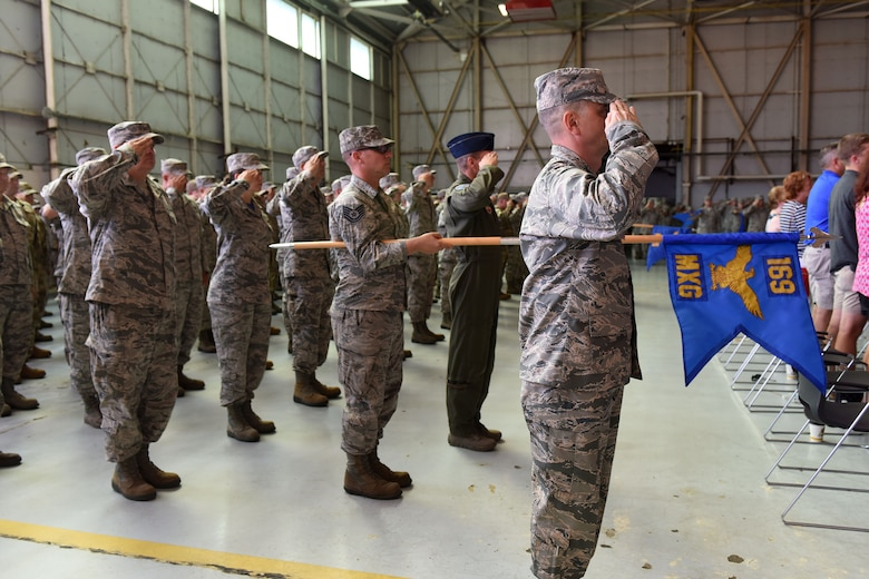 U.S. Airmen of the 169th Fighter Wing and the South Carolina Air National Guard, assemble for a change of command ceremony at McEntire Joint National Guard Base, S.C., June 23, 2018. Col. Nicholas Gentile Jr. relinquishes command of the 169th Fighter Wing to Col. Akshai Gandhi. (U.S. Air National Guard photo by Ashleigh Pavelek)