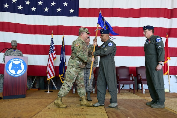 U.S. Airmen of the 169th Fighter Wing and the South Carolina Air National Guard, assemble for a change of command ceremony at McEntire Joint National Guard Base, S.C., June 23, 2018. Col. Nicholas Gentile Jr. relinquishes command of the 169th Fighter Wing to Col. Akshai Gandhi. (U.S. Air National Guard photo by Senior Airman Megan R. Floyd)