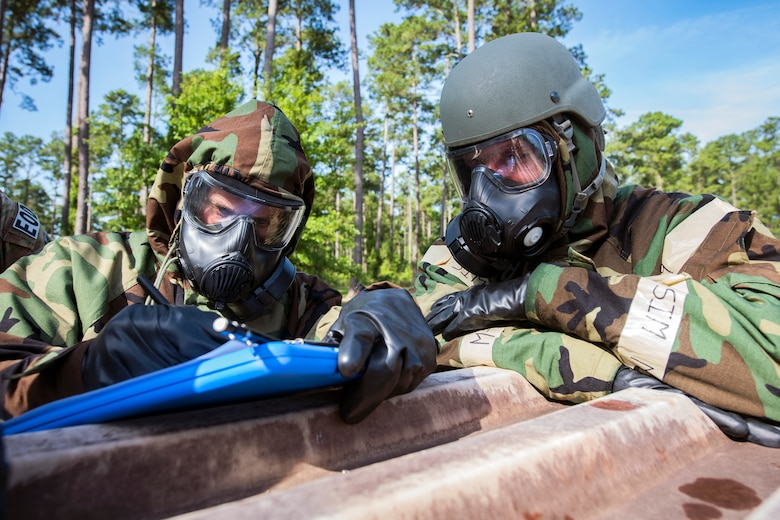 Airmen from the 23d Civil Engineer Squadron, take notes during a chemical, Biological, Radiological, Nuclear and Explosive (CBRNE) Olympics, June 21, 2018, at Moody Air Force Base, Ga.   Moody held its first CBRNE Olympics to further Airmen's overall knowledge on all of the aspects of CBRNE through a new method that was meant to establish a sense of competition and camaraderie. (U.S. Air Force photo by Airman 1st Class Eugene Oliver)