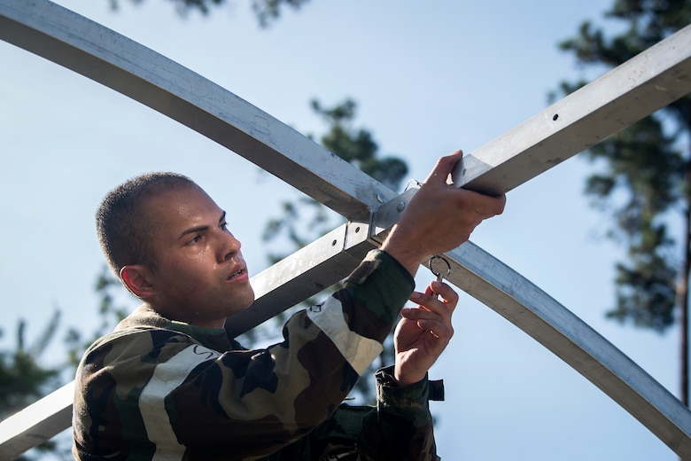 Airman First Class Phillip Pham, 23d Civil Engineer Squadron engineering assistant, assembles an Alaskan Small Shelter System during a Chemical, Biological, Radiological, Nuclear and Explosive (CBRNE) Olympics, June 21, 2018, at Moody Air Force Base, Ga.   Moody held its first CBRNE Olympics to further Airmen's overall knowledge on all of the aspects of CBRNE through a new method that was meant to establish a sense of competition and camaraderie. (U.S. Air Force photo by Airman 1st Class Eugene Oliver)