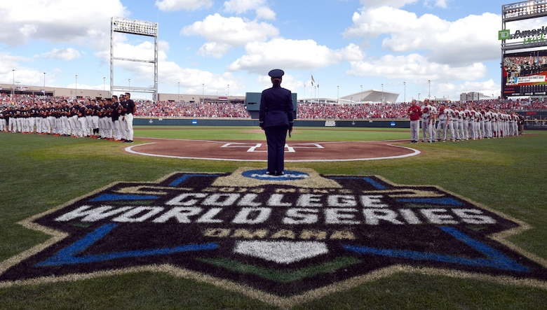 Airman 1st Class Aliyah Richling stands at home-plate after singing the national anthem at the National Collegiate Athletic Association Men's College World Series game at TD Ameritrade Park Omaha, Nebraska, June 26, 2018.