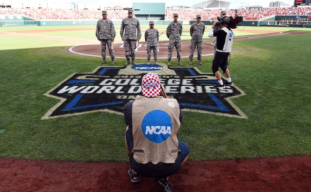 Airmen stand at home plate of TD Ameritrade Park for game one of the National Collegiate Athletic Association Men's College World Series Omaha, Nebraska, June 26, 2018.