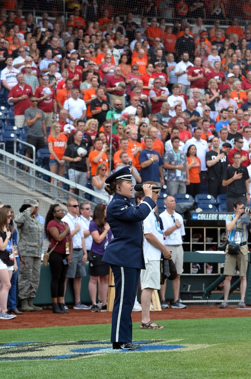 Airman 1st Class Aliyah Richling sings the national anthem at the National Collegiate Athletic Association Men's College World Series game at TD Ameritrade Park Omaha, Nebraska, June 26, 2018.